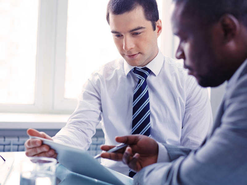 business men looking at charts